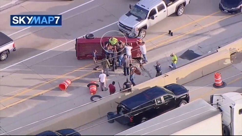 Good Samaritans flip overturned truck on busy Illinois