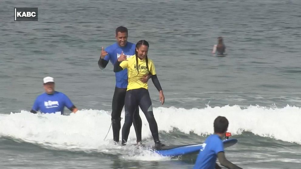 Woman battling several diseases finds healing through surfing