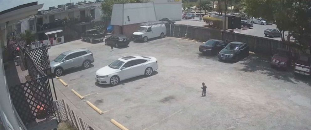 PHOTO: Surveillance video of the incident Wednesday shows the boy and his cousin walking far behind his mother, Gissel Vazquez, 18, in a Houston parking lot.