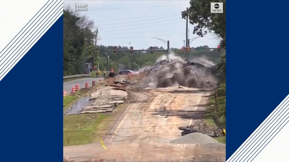 Wave of controlled blasts unearth road in Virginia