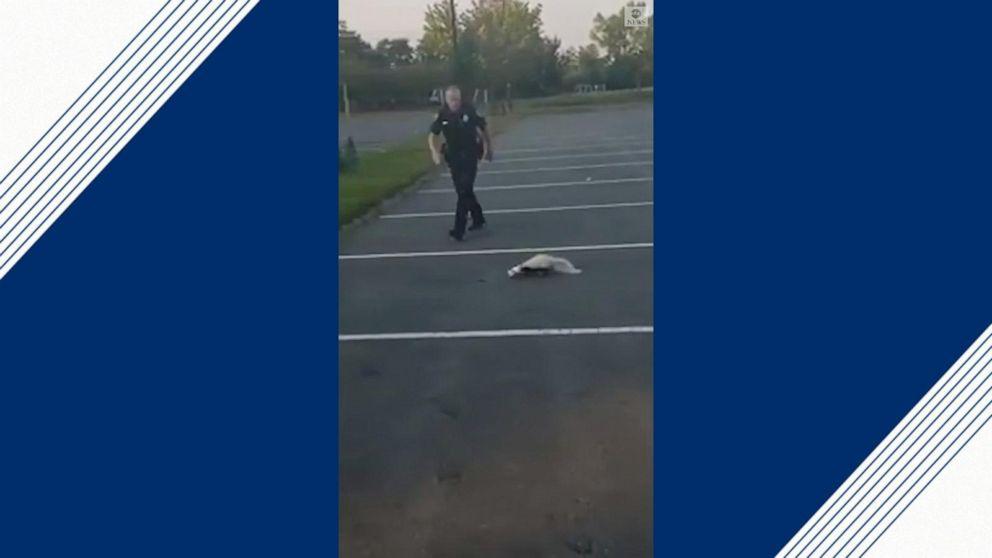 Police officer helps skunk with yogurt cup stuck on head