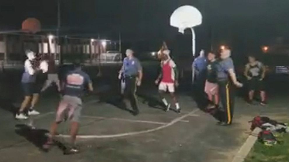 NJ police officers join pick-up hoops game
