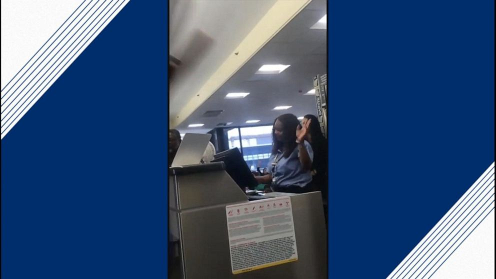 Airline employees sing to cheer up delayed passengers