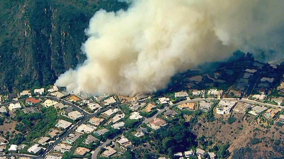Fast-moving wildfires destroy Southern California homes