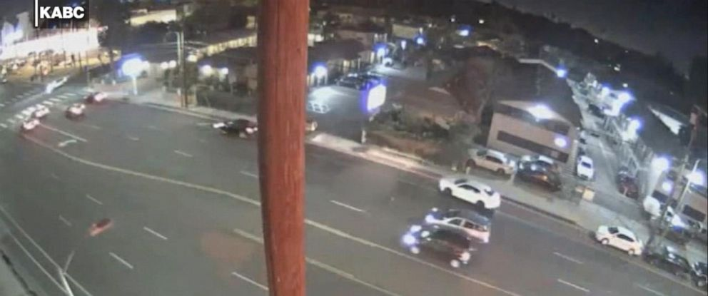 PHOTO: Surveillance video shows dozens of vehicles swerving around a hit-and-run victim (blurred circle, middle of frame) in Los Angeles.