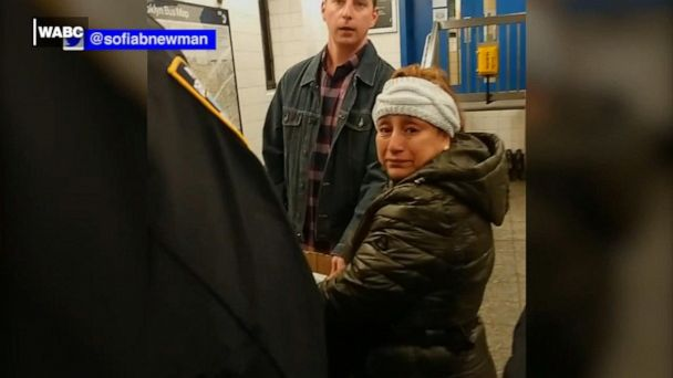 Police handcuff woman selling churros in Brooklyn subway station