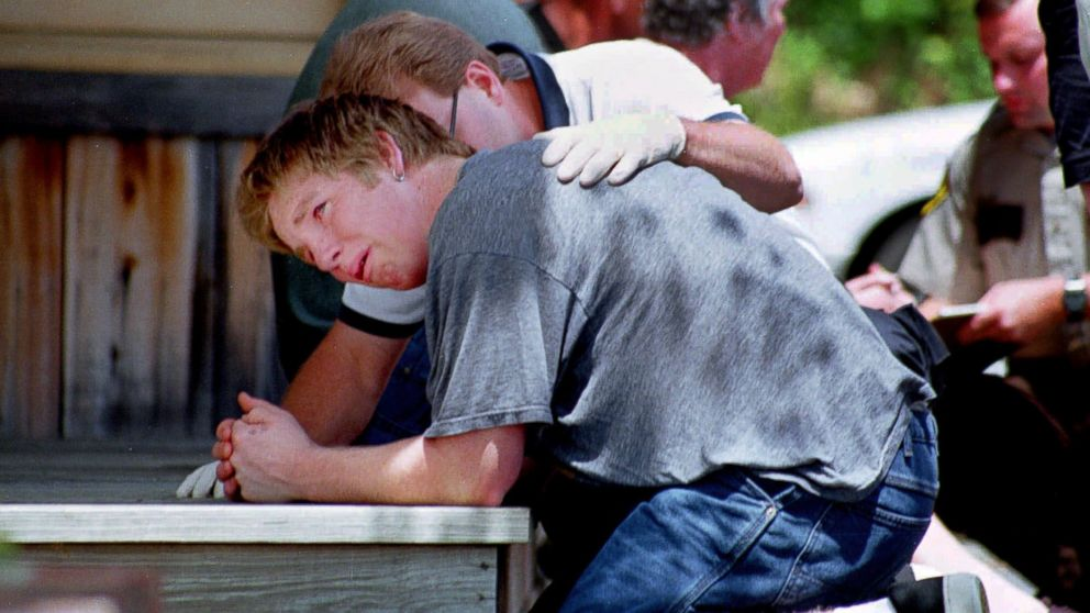 A rescue worker consoles a survivor of a amphibious tourist boat wreck on Lake Hamilton May 1, 1999, in Hot Springs Ark.