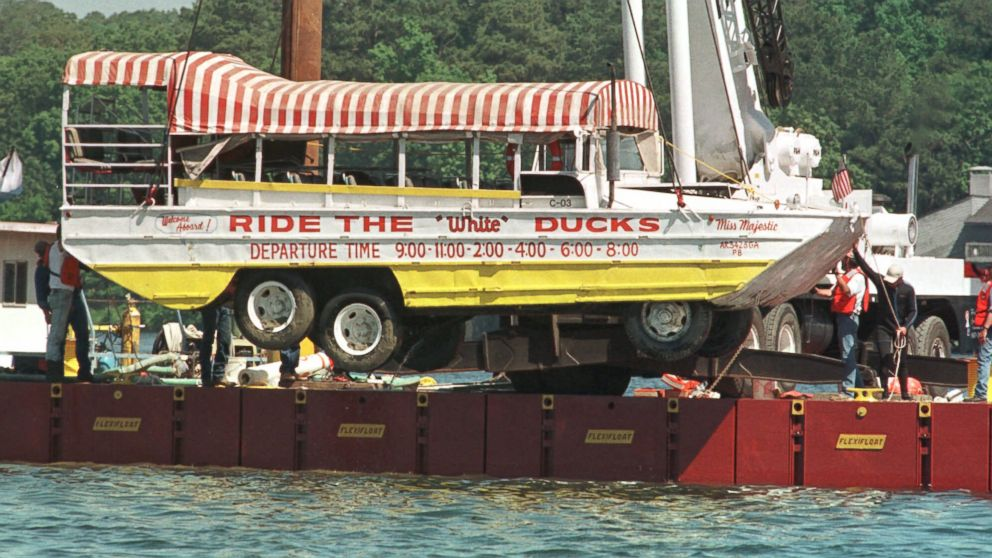 """The amphibious tourist boat """"Miss Majestic"""" that sank, May 1, 1999 in Lake Hamilton near Hot Springs, Ark., leaving 13 dead, is hoisted by a crane out of the lake, May 9, 1999."""