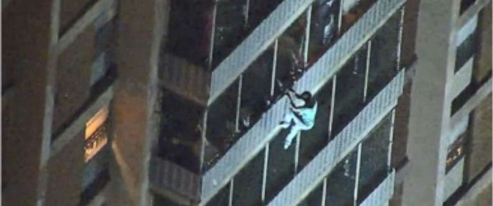 PHOTO: A man is seen climbing down a 19-story high-rise during a fire Thursday night in Philadelphia. He escaped unharmed.