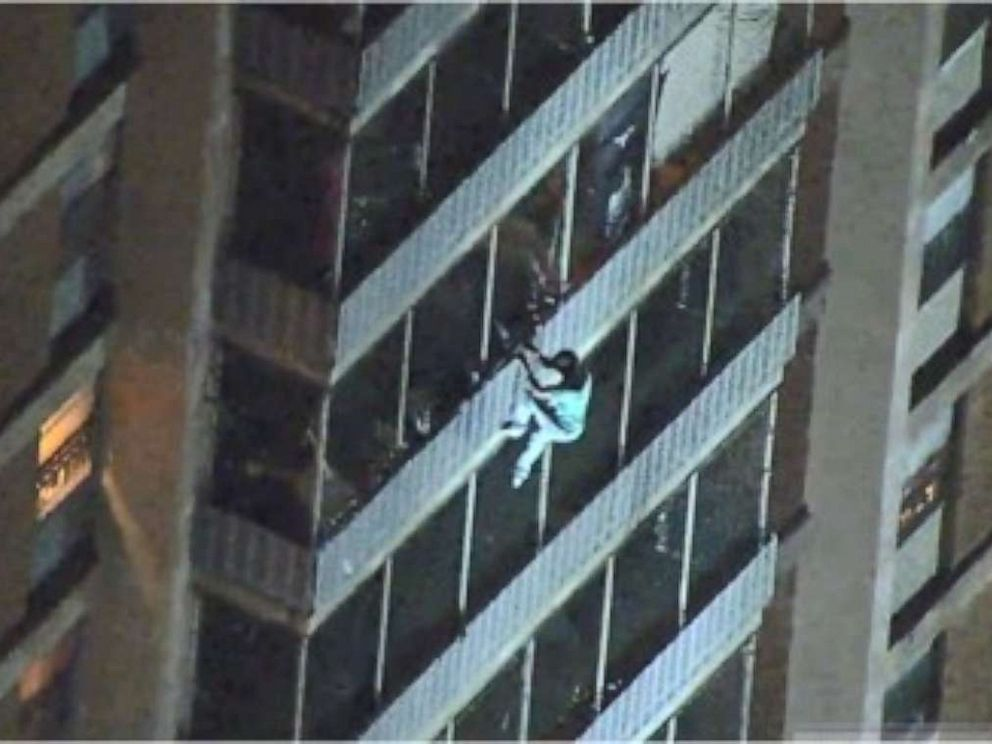 Video shows man climbing down a high-rise to escape a fire