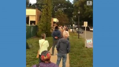 Long lines of people were seen outside polling stations in North Carolina as early in-person voting began.