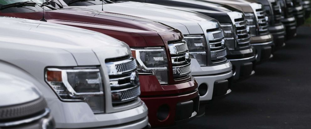 PHOTO: F-150 pickups are seen on a sales lot in North Miami, Fla., Sept. 4, 2013.