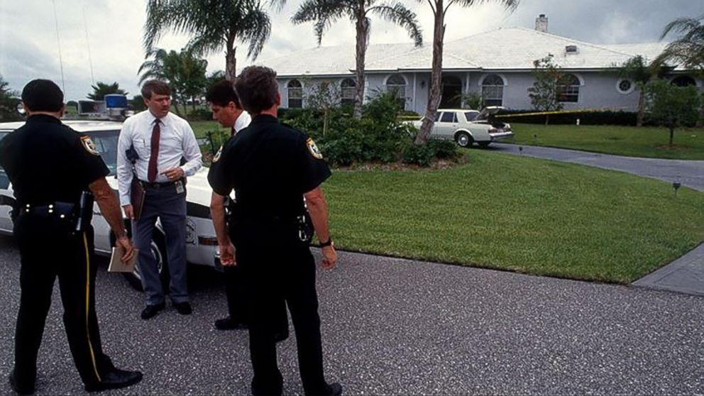 Police stand outside of Marlene Warren's house after her murder in this undated photo.