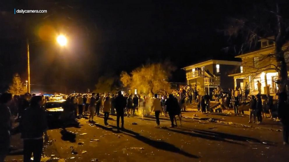 Hundreds clash with police at street party in Colorado