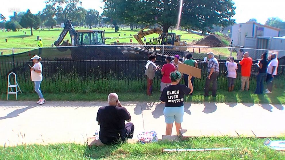 Protests over reburial of remains possibly linked to Tulsa victims