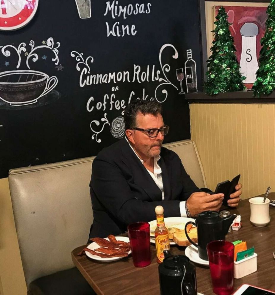 PHOTO: Dwayne Clark, CEO of Aegis Living, eating his usual breakfast at the Brief Encounter Cafe in Bellevue, Washington, on Dec. 18th after he left a generous tip for the staff over the weekend.