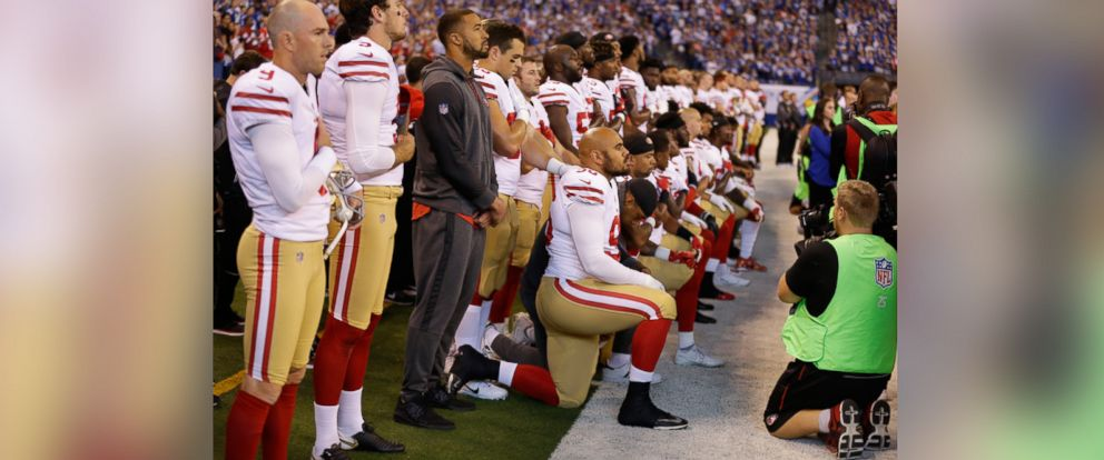 PHOTO: Members of the San Francisco 49ers kneel during the playing of the national anthem before an NFL football game against the Indianapolis Colts, Oct. 8, 2017, in Indianapolis.