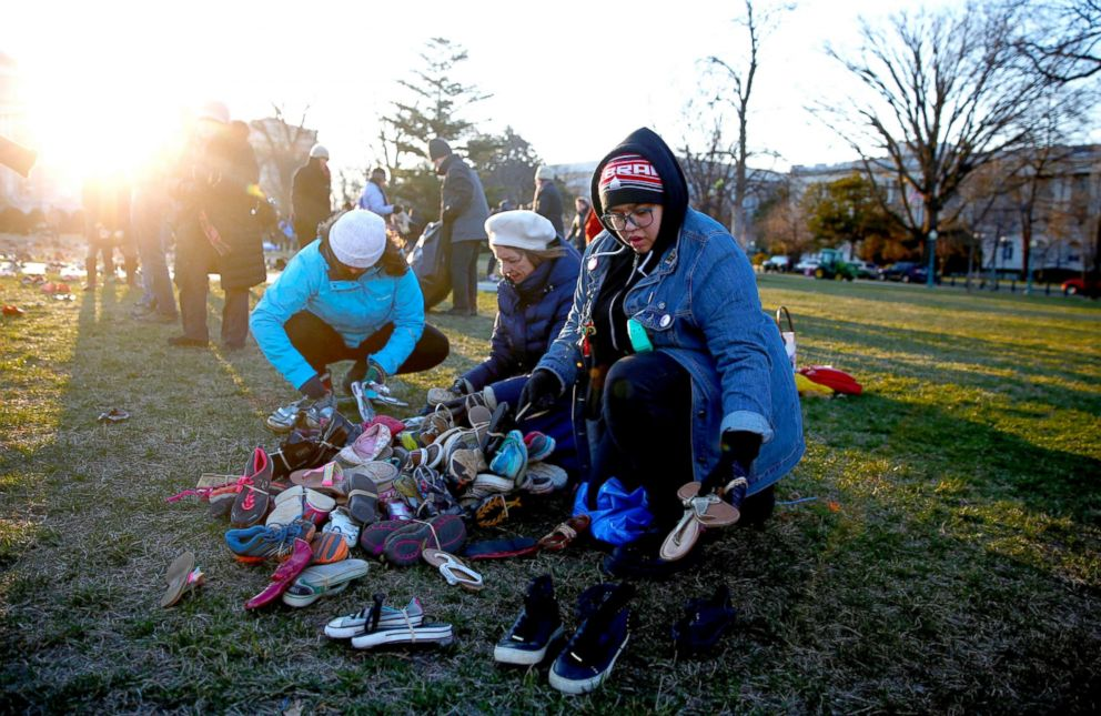 PHOTO: Members of the AVAAZ group install 7000 shoes on the lawn in front of the U.S. Capitol in Washington, March 13, 2018. The shoes represents the number of lives lost since the shooting at Sandy Hook elementary in Newtown, Ct.