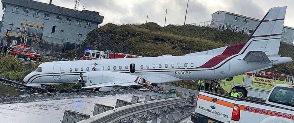 PHOTO: Alaska Airlines Flight 3296, operated by Peninsula Airways, sits at the edge of Unalaska Bay after running off the runway while landing at Unalaska/Dutch Harbor Airport, Oct. 18, 2019.