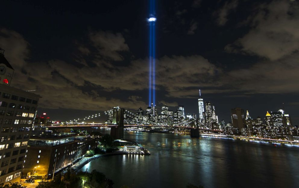 PHOTO: Tribute in Light illuminate the New York City sky between the Twin Towers of the World Trade Center in New York to mark the 14th anniversary of the 2001 terrorist attacks on Sept. 11, 2015.
