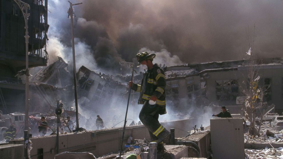A New York City Firefighter makes his way amid the rubble of the World Trade Center following the attacks on the Twin Towers, Sept. 11, 2001.