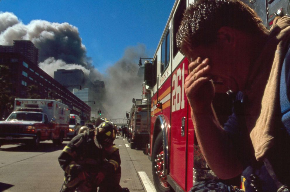 PHOTO: New York City Firefighters near the site of the World Trade Center following the attacks, Sept. 11, 2001.