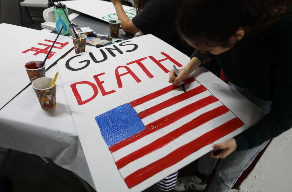 PHOTO: A student paints a sign to be carried at the upcoming March for Our Lives on March 22, 2018 in Los Angeles.