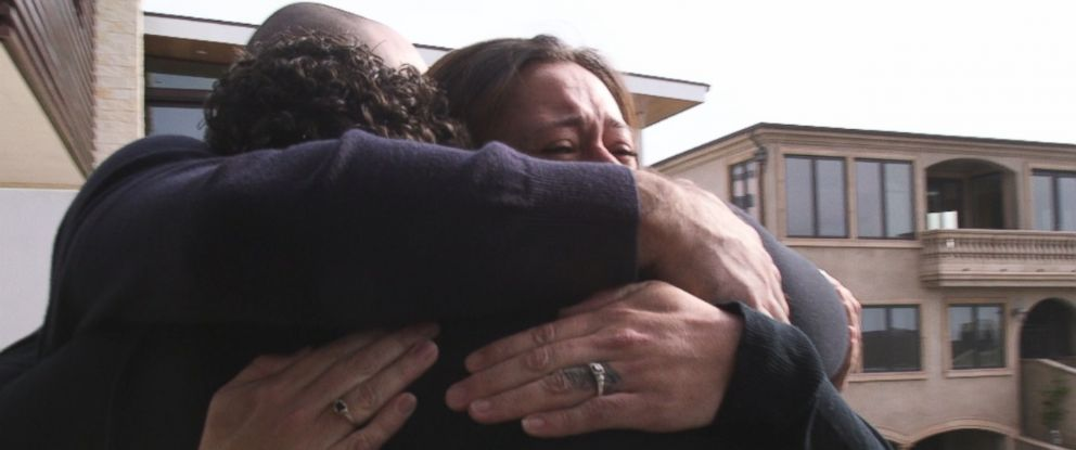 PHOTO: Julie Hutchison and her half-siblings Dean Hundorf and Janet Barnicoat hug for the first time.