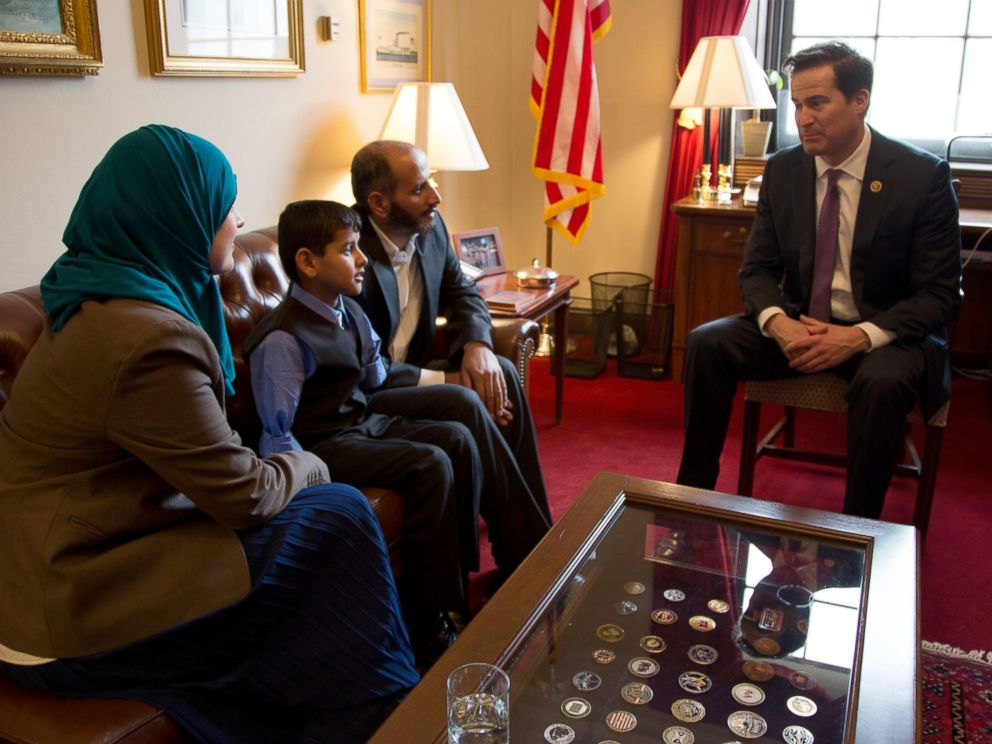 PHOTO: Ahmad Alkhalaf, 9, sits with his father, center right, Nadia Alawa, executive director at NuDay Syria, and Congressman Seth Moulton.