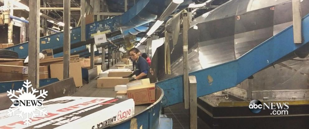PHOTO: FedEx workers in Newark, NJ, handle an increasing number of packages during the holiday season.