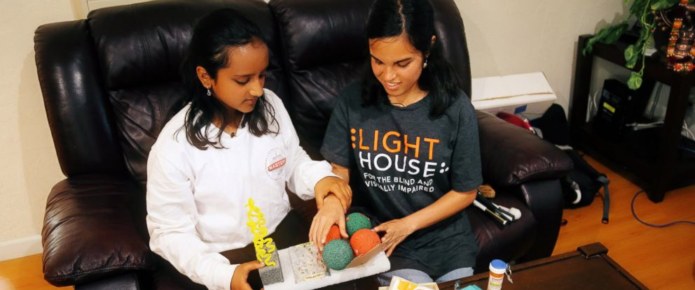 """PHOTO: Hari Bhimaraju, 12, describes her periodic table tool """"The Elementor"""" at her home in Cupertino, California."""