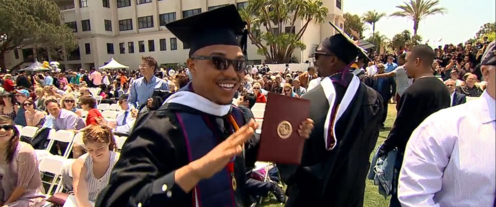 PHOTO: Kenneth Chancey, 23, gets his diploma at Loyola Marymount University.
