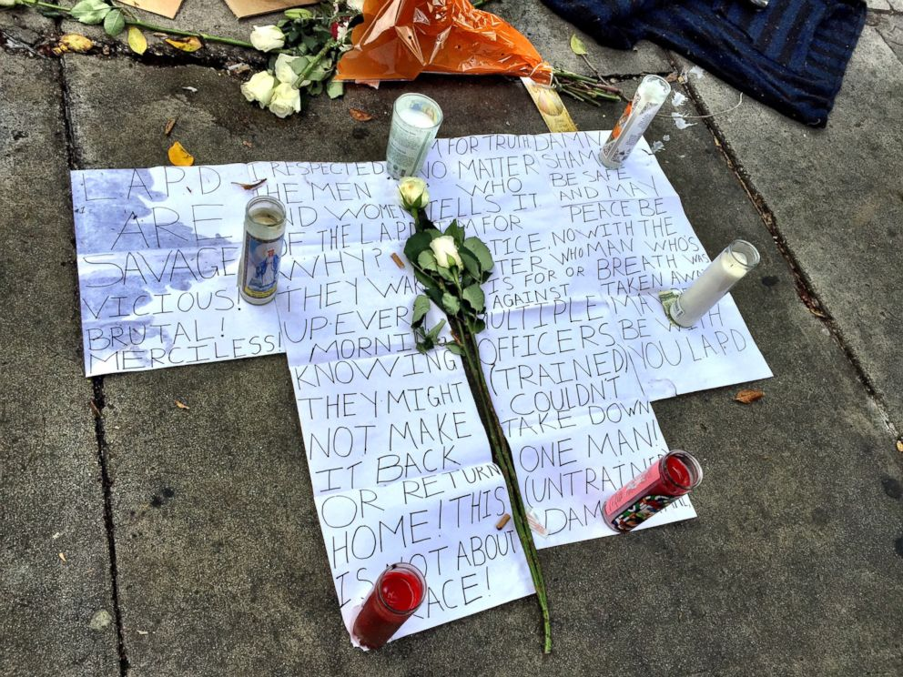 PHOTO: Flowers and signs were seen on Monday March 2 near the site of the shooting of a man on Los Angeles Skid Row.