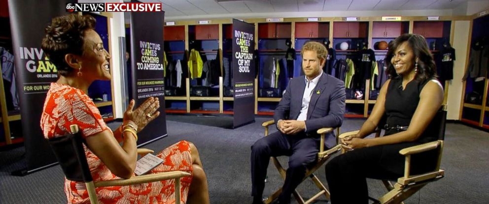 "PHOTO: Prince Harry and First Lady Michelle Obama speak to ""Good Morning America"" co-anchor Robin Roberts about the Invictus Games in Orlando, Fla."