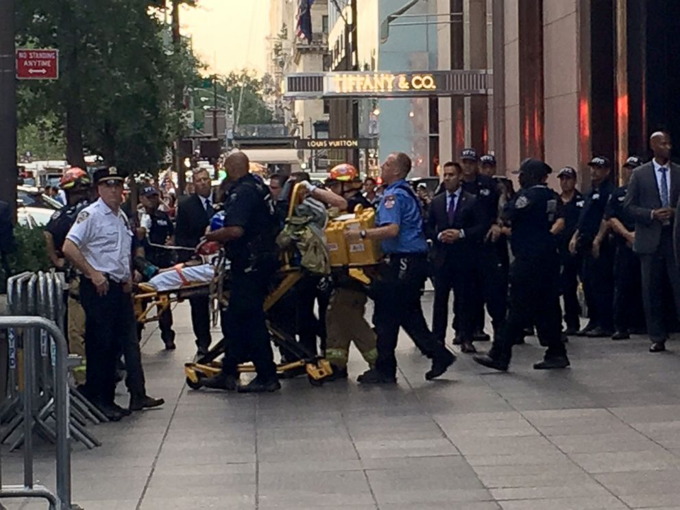 PHOTO: The suspect who scaled the side of Trump Tower in Midtown, Manhattan was removed from the building on a stretcher.