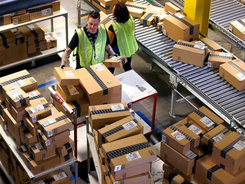 PHOTO: Amazon.com employees organize outbound packages at an Amazon.com Fulfillment Center on Cyber Monday the busiest online shopping day of the holiday season, in Phoenix.