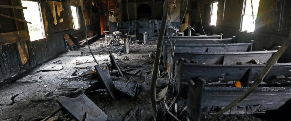 PHOTO:Burned pews, destroyed musical instruments, Bibles and hymnals are part of the debris inside the fire damaged Hopewell M.B. Baptist Church in Greenville, Mississippi, Nov. 2, 2016.