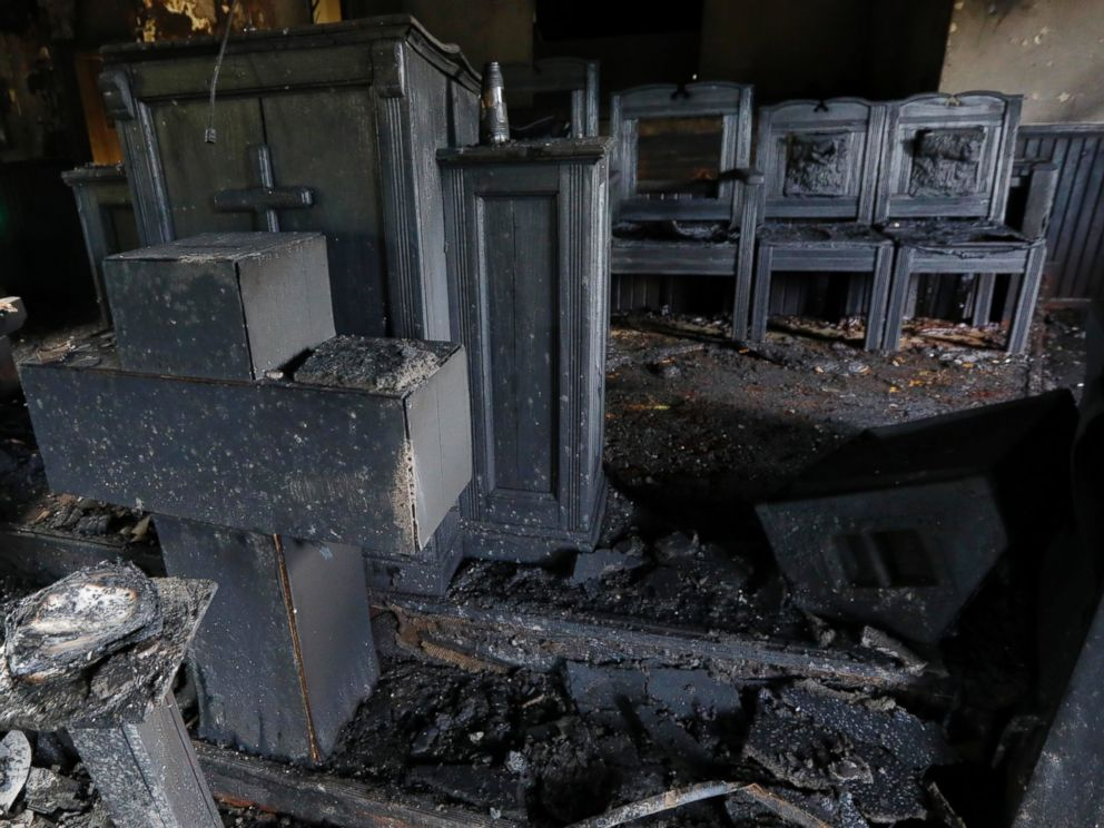 PHOTO: Burned pews, destroyed musical instruments, Bibles and hymnals are part of the debris inside the fire damaged Hopewell M.B. Baptist Church in Greenville, Mississippi, Nov. 2, 2016.