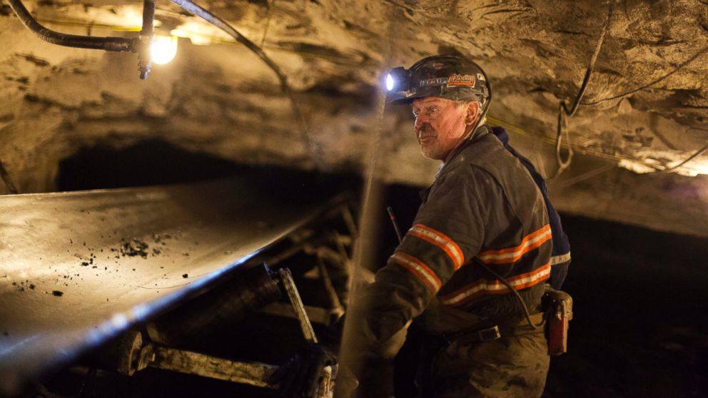Scott Tiller, a coal miner of 32 years, looks over a belt moving coal out of an underground mine in Welch, W.Va on May 11, 2016.