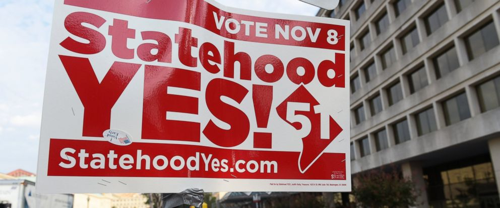 PHOTO: Signs supporting DC statehood are on display outside an early voting place on in Washington, on Nov. 3, 2016.