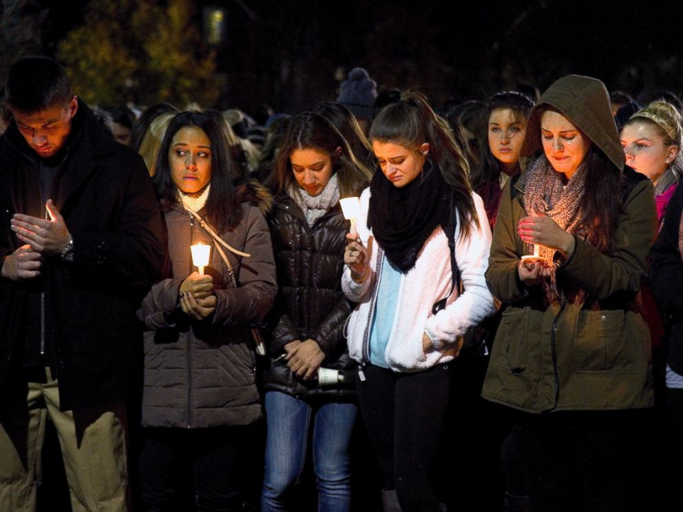 PHOTO: West Virginia Univeristy students hold a candlelight vigil in memory of Nolan Michael Burch in Morgantown, W.Va., Nov. 14, 2014. Burch, 18, died two days after officers were called to the Kappa Sigma house and found someone performing CPR on him.