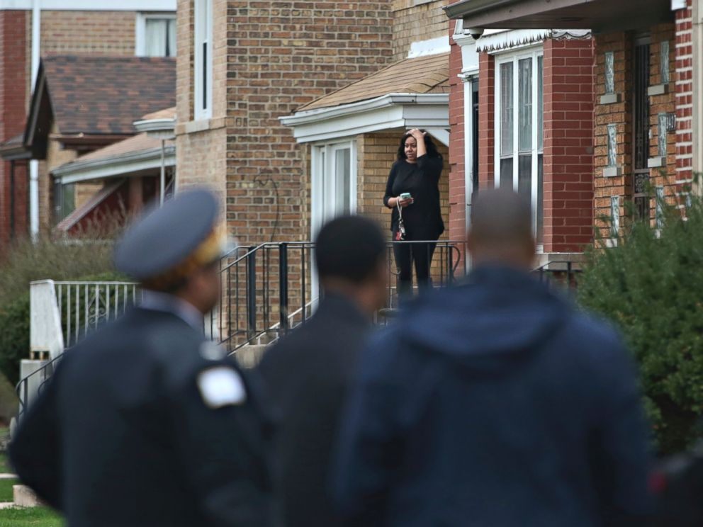 PHOTO: Authorities gather on a residential street on the South Side of Chicago, April 10, 2017, after Cook County Circuit Court Judge Raymond Myles was shot to death outside his home.