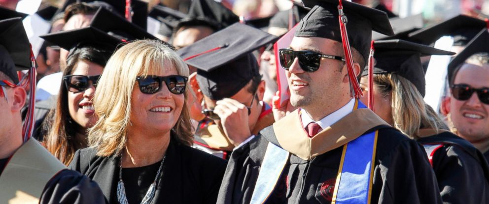 PHOTO: Judy OConnor, center, sits with her son, MBA graduate Marty OConnor, during commencement at Chapman University in Orange, Calif., May 20, 2017.