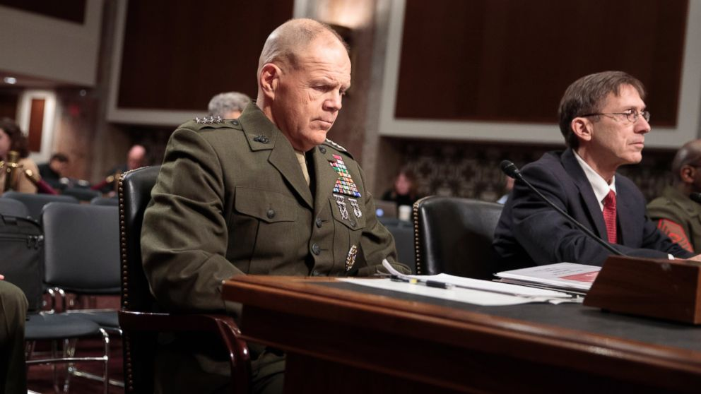 """Marine Corps Commandant Gen. Robert B. Neller, left, and Acting Navy Secretary Sean J. Stackley, prepare to testify on Capitol Hill in Washington, on March, 14, 2017, before the Senate Armed Services Committee hearing to investigate nude photographs of female Marines and other women that were shared on the Facebook page """"Marines United."""""""