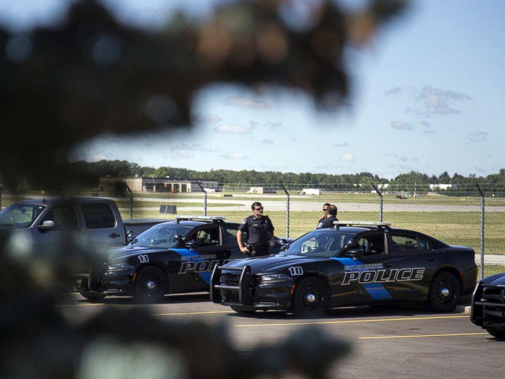 PHOTO: Burton Police Officers gather at Bishop International Airport, June 21, 2017, in Flint, Mich.