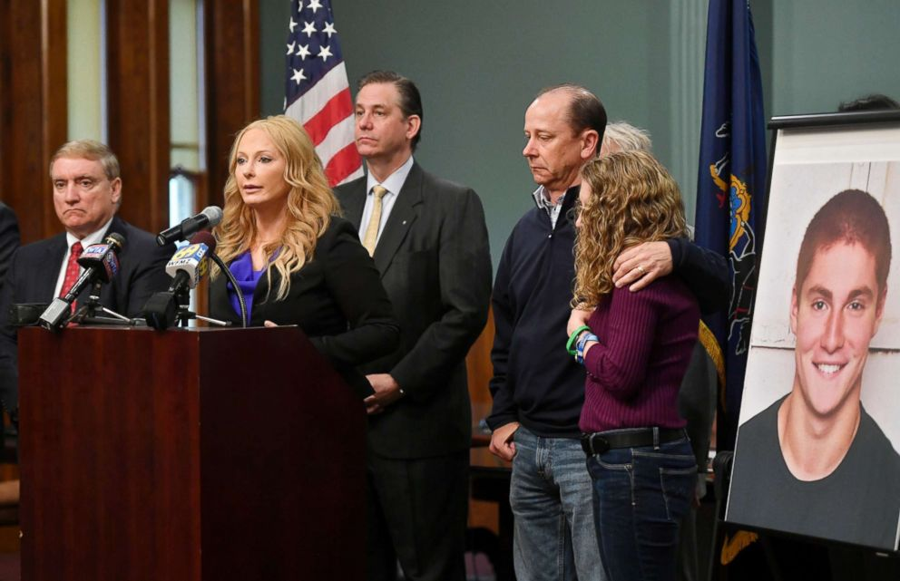 Jim and Evelyn Piazza, right, stand by as Centre County District Attorney Stacy Parks Miller, second from left, announces the results of an investigation into the death of their son Timothy Piazza during a press conference, May 5, 2017, in Bellefonte, Pa.