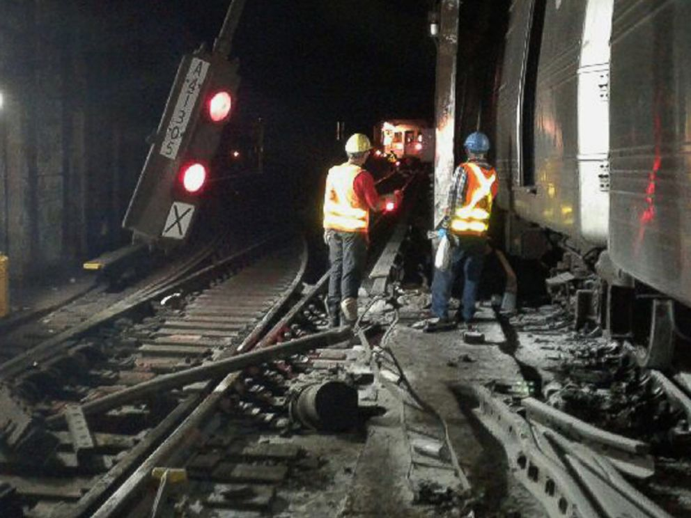 PHOTO: In this photo provided by the Transport Workers Union, Local 100, workers from the New York Metropolitan Transportation Authority respond to the scene of a subway derailment, June 27, 2017, in New York City.