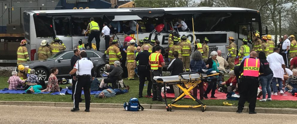 PHOTO: Biloxi, Miss., firefighters help passengers of a charter bus out of the damaged vehicle after the bus collided with a train, March 7, 2017. At least 3 people are dead .