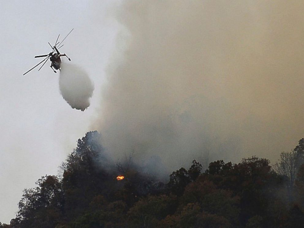PHOTO: Crews work a wildfire near Lake Lure, North Carolina, in Rutherford County, Nov. 11, 2016.