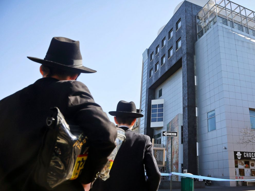 PHOTO: Two young men who left a nearby synagogue watch police activity outside the Jewish Childrens Museum following a bomb threat in Brooklyn borough of New York, March 9, 2017.